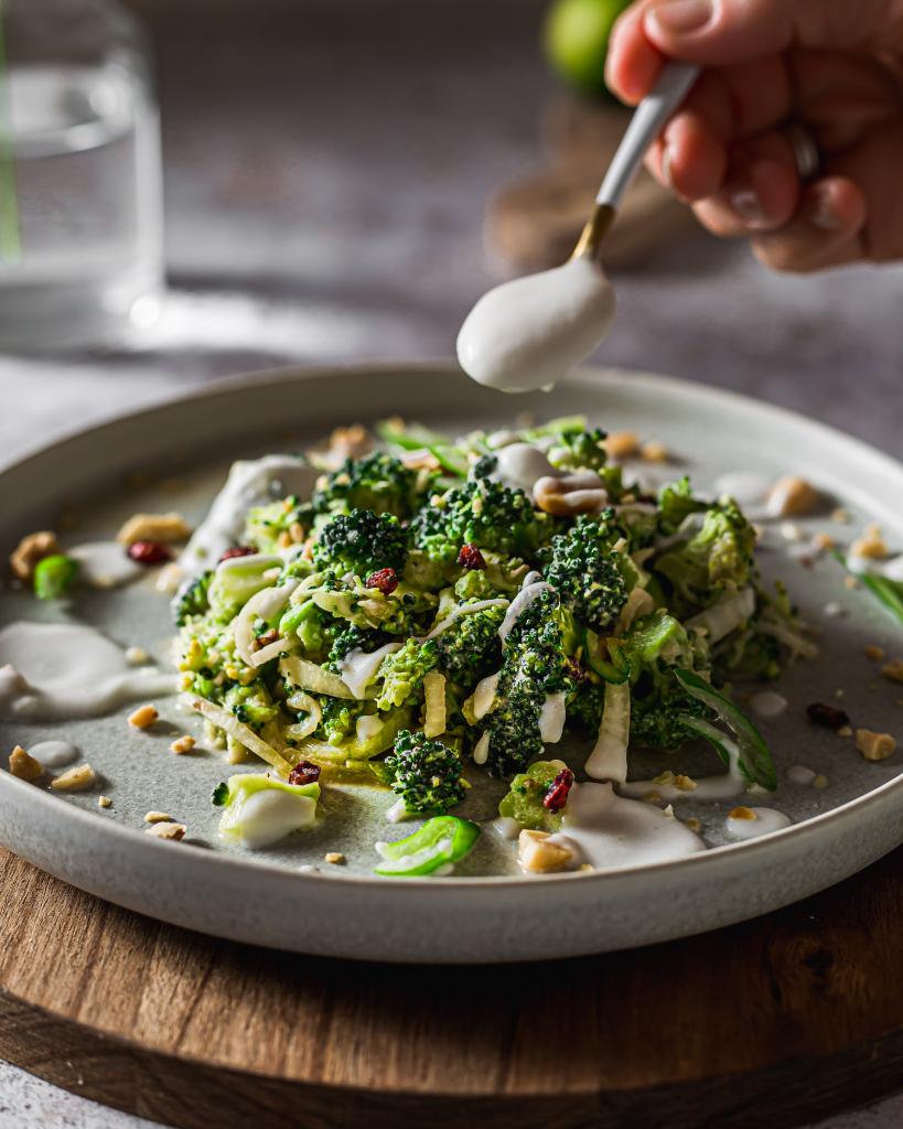 raw broccoli with coconut milk spoon
